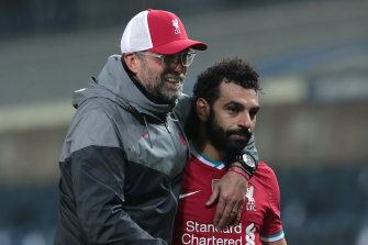 Jurgen Klopp, left, may be without Mohamed Salah for Liverpool's clash against Leicester City.