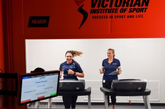 Sports scientist Sylvie Withers with sailor Casey Imeneo using the heat acclimatising chamber at the Victorian Institute of Sport.
