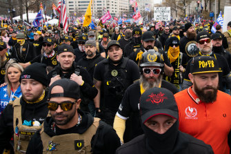 Demonstrators wearing Proud Boys attire during the protest march in Washington, D.C. on Saturday. The protests there, and in Washington state, later turned violent.