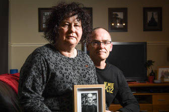 Robyn and Matt Cronin with a photograph of their son, Pat in 2018.