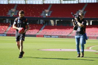 An Amazon camera crew tracks Stephen Coniglio for the documentary on the GWS Giants that will be released next year.