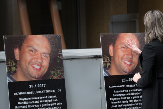 Posters of Raymond Noel posted to the outside walls of the court on Friday.