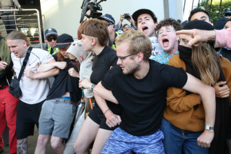 Protesters try to stop delegates entering the International Mining and Resources Conference in Melbourne on Wednesday.