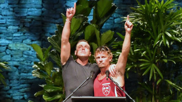 Ruben McDornan (left), who was the sole survivor of the sunken Dianne, points to the sky with second skipper Adam Kelly at the memorial service.