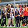 'It's a big loss for him': Junior footy postponement a social blow