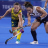 Australia's Ambrosia Malone and Japan's Yukari Mano vie for possession on Wednesday night.