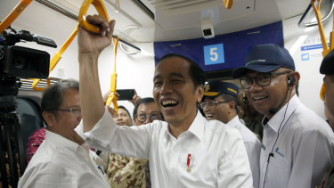 President Jokowi rides the MRT in Jakarta, a project he began as the city's governor.