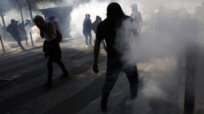 Paris police fire tear gas, arrest 163 people as trio of protests turns violent