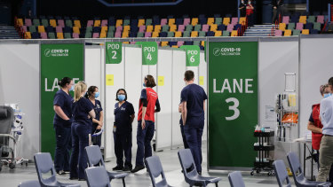 Staff at the Brisbane Entertainment Centre mass vaccination hub at Boondall, in the city's north.