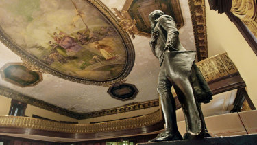 a statue of Thomas Jefferson, right, stands in New York's City Hall Council Chamber. The 1833 statue will be taken out of New York's City Hall in the coming days and sent to the New-York Historical Society as a long-term loan, capping longstanding efforts to remove the founding father's likeness because he owned slaves.