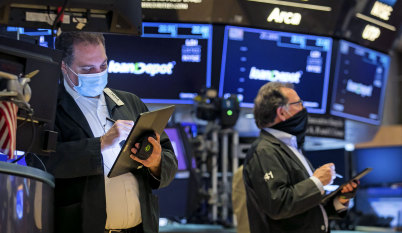 US stocks fluctuate; ASX set to open lower as iron ore price tumbles