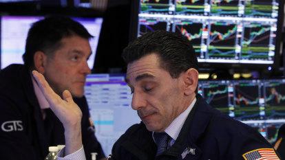 Wall Street slides lower on grim jobs report