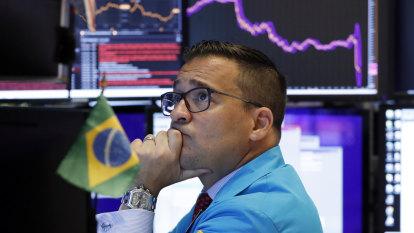 Banks drag ASX lower, Aussie dollar spikes