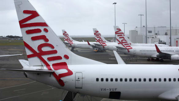 Virgin cleared for take-off as would-be buyers look on