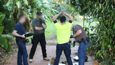 Police arrest one of their suspects in Atherton, QLD.