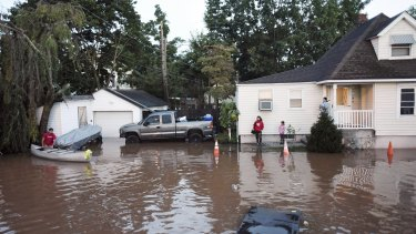 Residents are surrounded by floodwaters in the aftermath of Hurricane Ida in Manville, New Jersey.