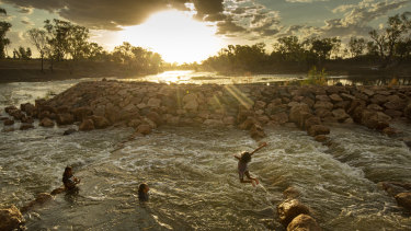Kids swimming in the fishway at Brewarrina Weir, north-west NSW in February when the first strong flows in years came down the dry Barwon River in the Murray Darling Basin.