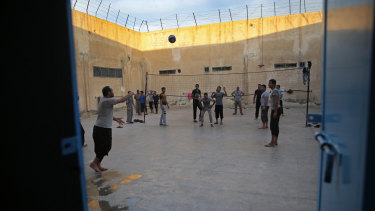 Prisoners play volleyball, in a Kurdish-run prison in Qamishli housing former members of IS.