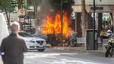 Hassan Khalif Shire Ali's ute on fire in Bourke Street in 2018.
