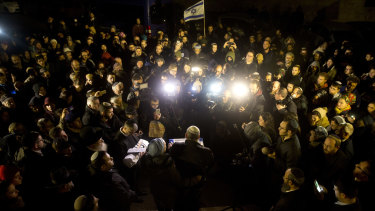 People attend the funeral of a baby who died after being prematurely delivered after her mother Shira Ish-Ran was wounded in attach in the West Bank.