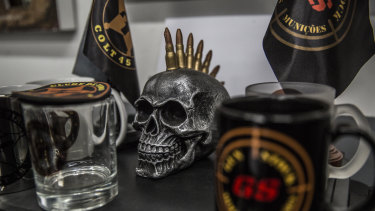 A skull sculpture sits next to merchandise at the reception area inside the Colt 45 club in Rio.