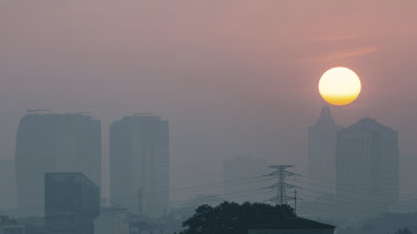 The sun struggles to shine through the Jakarta smog.