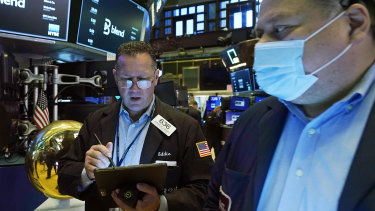 Wall Street was sharply lower at lunch but pared some of its losses in the afternoon.