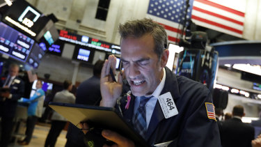 A New York trader reacts as stocks plunge.