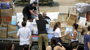Volunteers prepare donations to be sent to bushfire-affected areas.