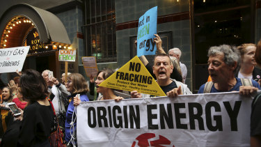 Climate activists and traditional owners protesting outside Origin Energy's AGM in Sydney.