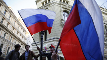 Some Russian fans wave the national flag in Moscow on the eve of the World Cup.