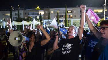 Israelis gather in a rally to support a unity government to oust Israeli Prime Minister Benjamin Netanyahu from office on Monday.