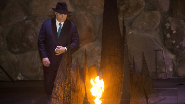 Hungarian Prime Minister Viktor Orban rekindles the eternal flame during a memorial ceremony at the Yad Vashem Holocaust Memorial in Jerusalem.