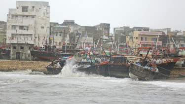 Fishing boats bombard on a wall due to heavy winds and huge waves in the Arabian sea at Veraval, Gujarat, India in June of last year.