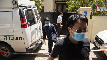 Men leave the house of China's ambassador to Israel, Du Wei, after he was found dead in his home in Herzliya, Israel.