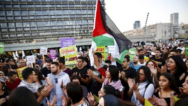 Israeli Arabs hold a Palestinian flag during a protest against the Jewish nation bill in Tel Aviv on Saturday.