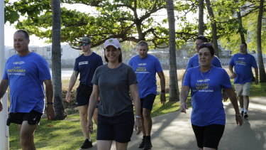 LNP leader Deb Frecklington and Townsville-region candidates walk along the Strand in week one of the campaign.