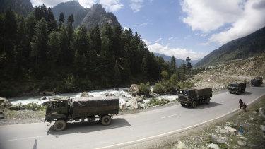 An Indian army convoy moves on the Srinagar-Ladakh highway at Gagangeer, north-east of Srinagar, Indian-controlled Kashmir.