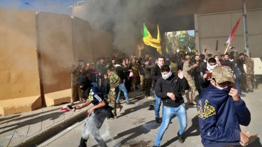 US soldiers fire tear gas towards protesters who broke into the US embassy compound in Baghdad.
