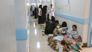 Patients suffering from suspected cholera wait to receive treatment at a hospital in Yemen's capital, Sanaa.
