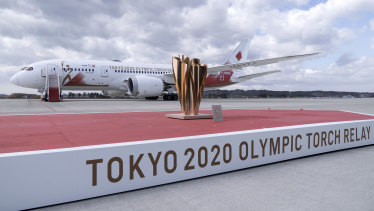 The cauldron on stage in front of the aircraft transporting the Olympic flame at Matsushima Air Base on March 20.