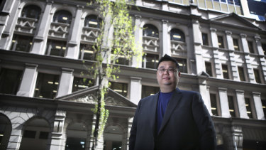 iProperty Group CFO Michael Gu in front of the company's property at 333 Kent St, Sydney.
