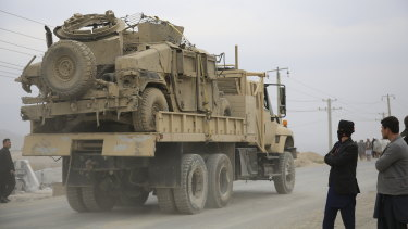 Exiting: A military vehicle damaged by a blast is transported in Kabul, Afghanistan.