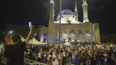 Anti-government protesters wave Lebanese flags in Martyrs' Square on October 29.