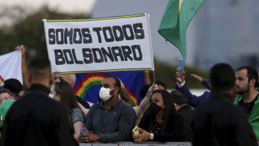 "Crowds gather in front of the Planalto presidential palace to show their support for Brazil's President Jair Bolsonaro most days. The sign reads ""We are all Bolsonaro"" in Portuguese."