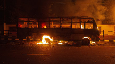 A bus stand in flames after demonstrators set it on fire as they protest against the Citizenship Amendment Bill (CAB) in Gauhati, India.