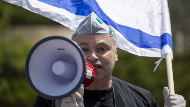 An Israeli supporter of Prime Minister Benjamin Netanyahu protests in front Israel's Supreme Court, in Jerusalem on Tuesday.