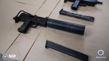 A number of guns were allegedly seized in a police raid on a home in Old Guildford.
