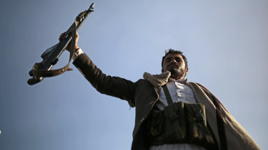 A Houthi supporter holds his weapon during a demonstration against the United States over its decision to designate the Houthis a foreign terrorist organisation in Sanaa, Yemen, on Monday.