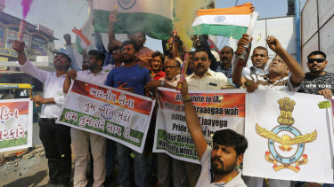 Indians celebrate in Ahmadabad as they react to reports of Indian aircrafts bombing Pakistan territory.